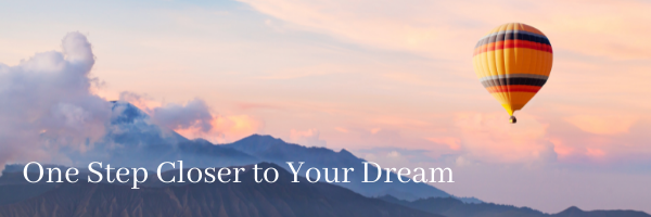 """Hot air balloon soaring over mountains in the sunset, with title text: """"One Step Closer to Your Dreams"""""""