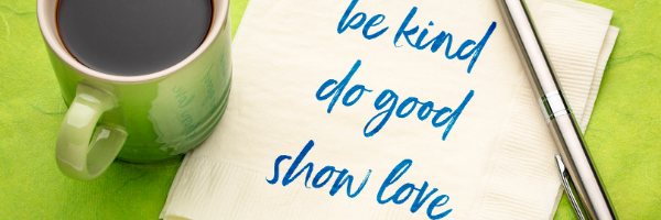 Green coffee cup and napkin with the words, be kind do good show love