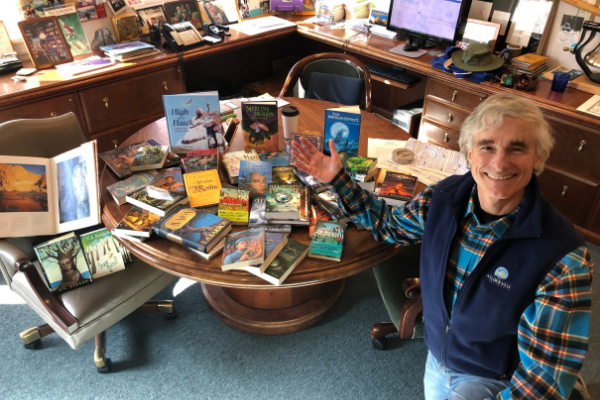 T. A. Barron with all of his published books on a table